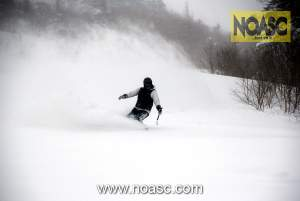 NOASC Iwanai CAT skiing client enjoying his turns